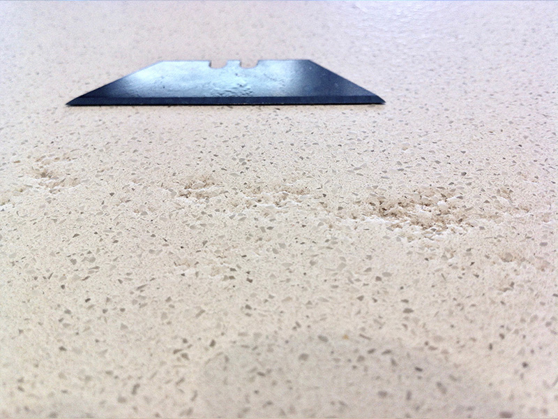 Engineered Stone Etch Repair Before