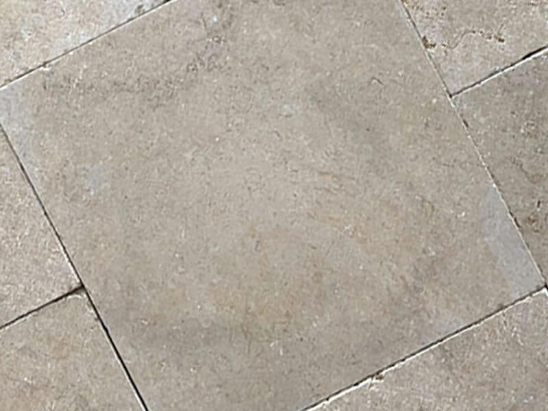 Sandblasted limestone tile