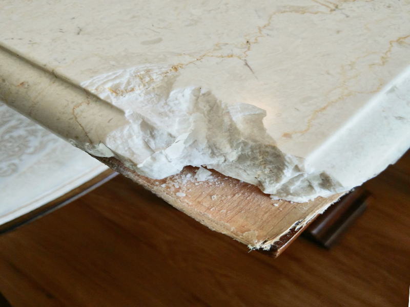 White marble coffee table chip repair BEFORE