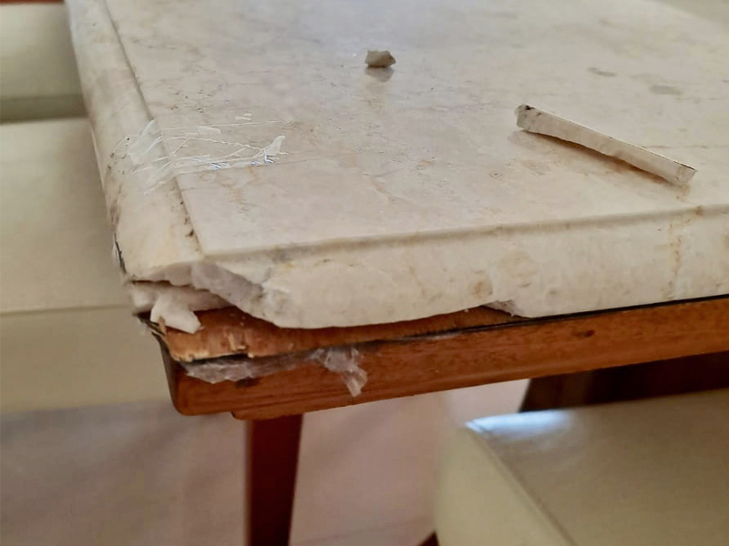 White marble table chip repair BEFORE